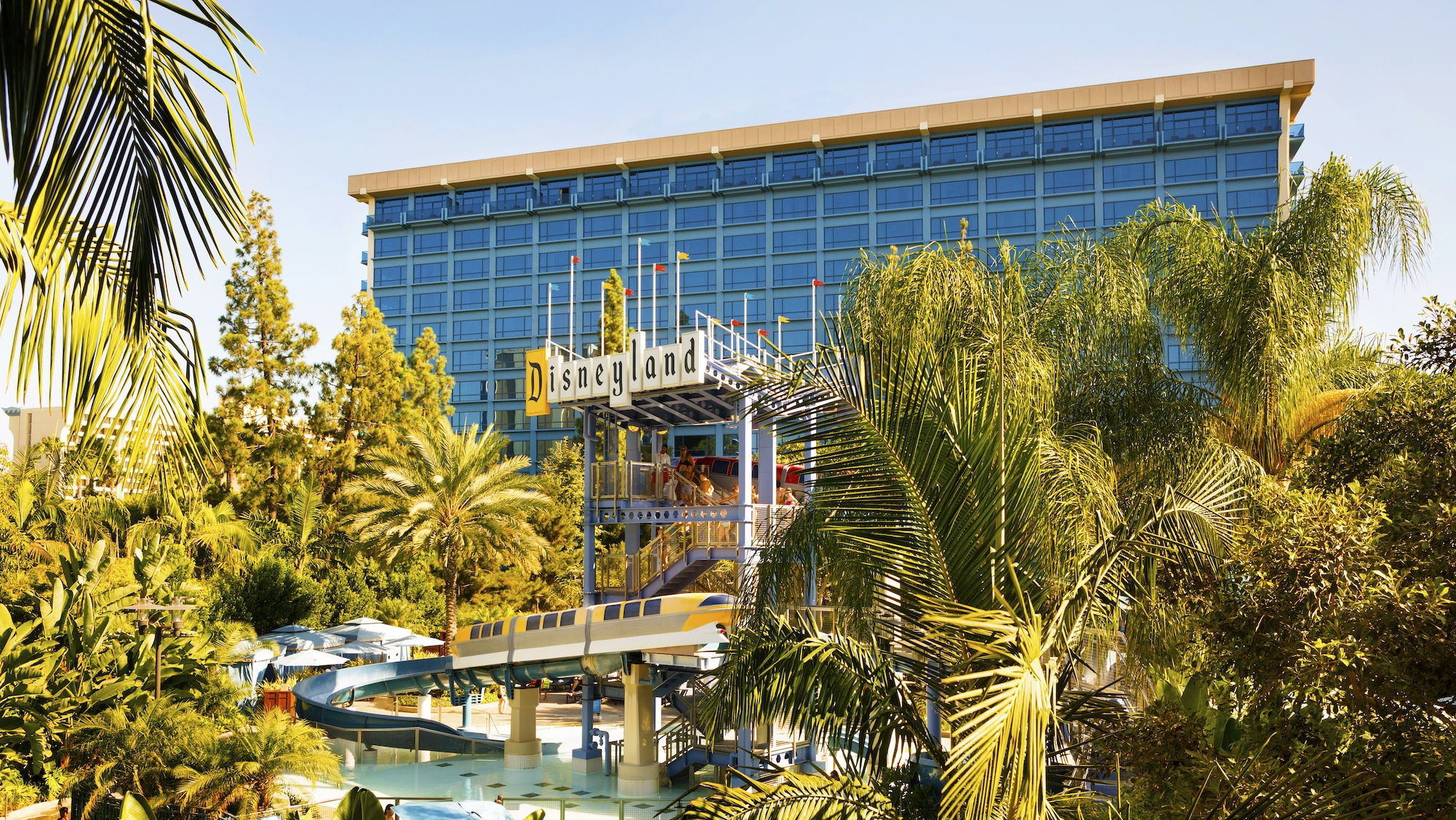 Image of exterior and the pool at the Disneyland Hotel.