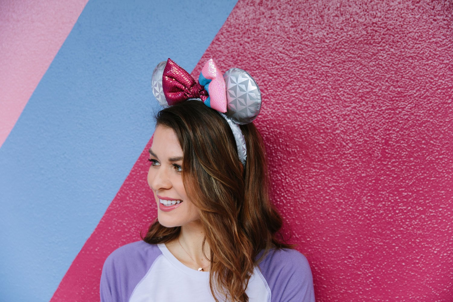Model wearing Epcot bubblegum wall inspired Mickey ears