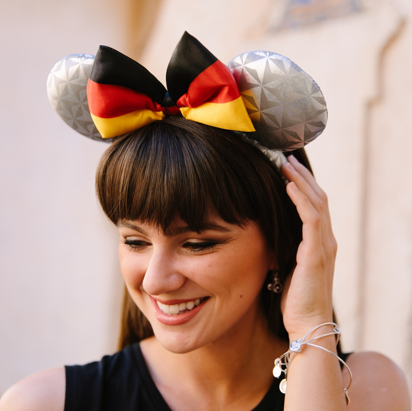 Model wearing Epcot's Earth-inspired Germany Mickey ears