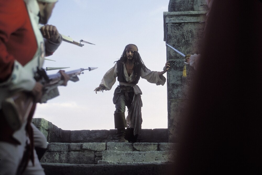 Jack Sparrow escaping from soldiers