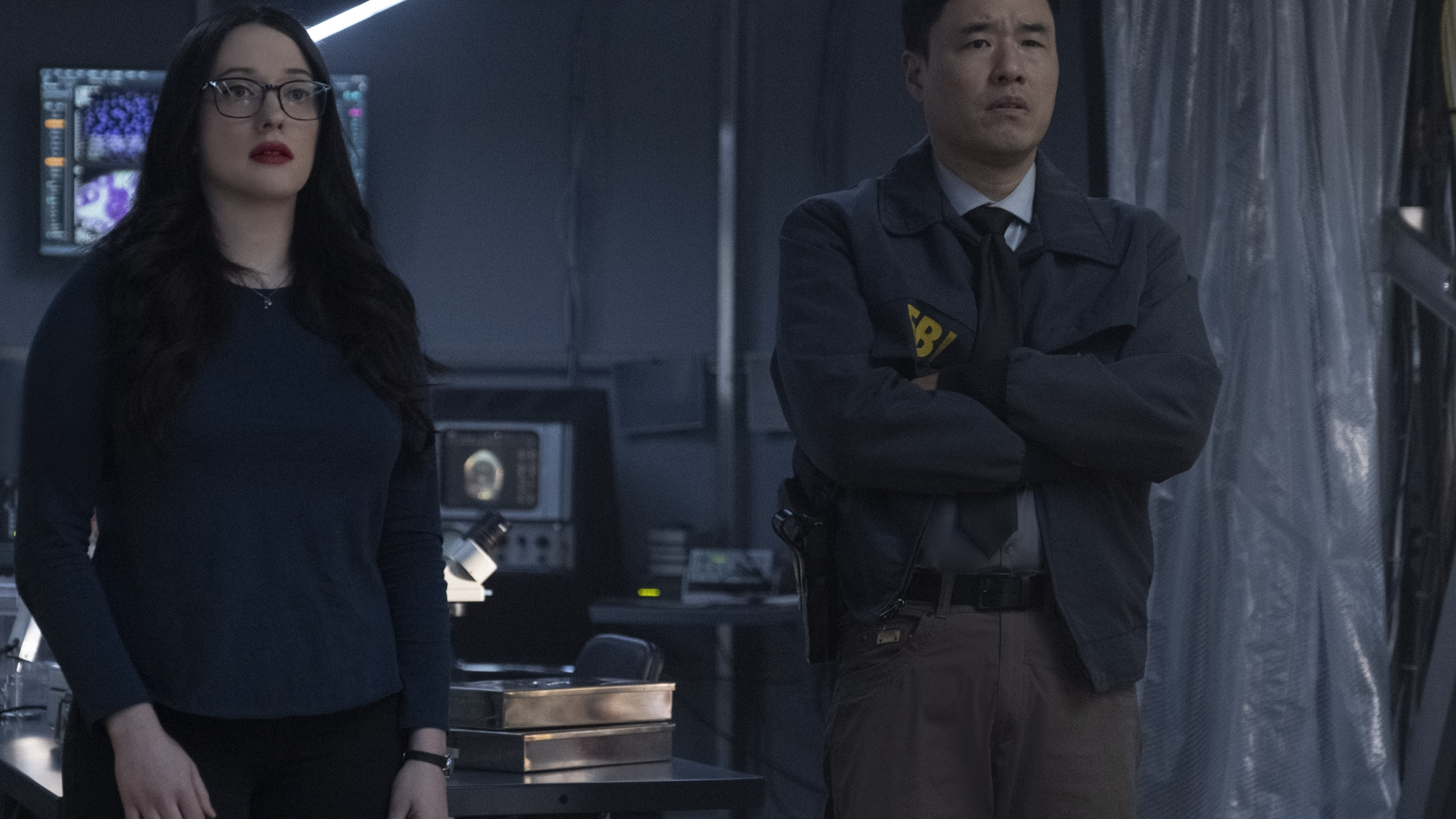 (L-R): Kat Dennings as Darcy Lewis and Randall Park as Jimmy Woo in Marvel Studios' WANDAVISION exclusively on Disney+. Photo by Chuck Zlotnick. ©Marvel Studios 2021. All Rights Reserved.