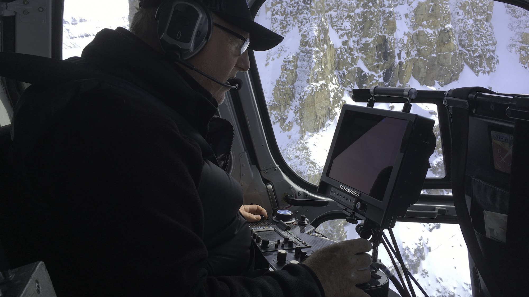 Aerial cinematographer Thomas Miller films elusive Arctic whales with a specialty camera stabilizer called a Cineflex. (National Geographic for Disney+/Thomas Miller)