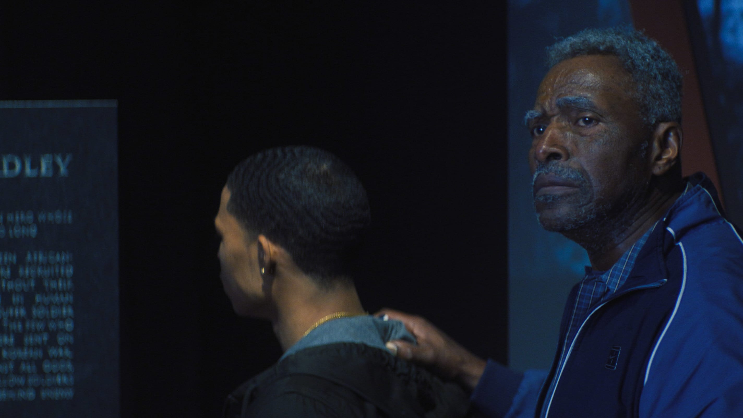 (L-R): Eli Bradley (Elijah Richardson) and Isaiah Bradley (Carl Lumbly) in Marvel Studios' THE FALCON AND THE WINTER SOLDIER exclusively on Disney+. Photo courtesy of Marvel Studios. ©Marvel Studios 2021. All Rights Reserved.