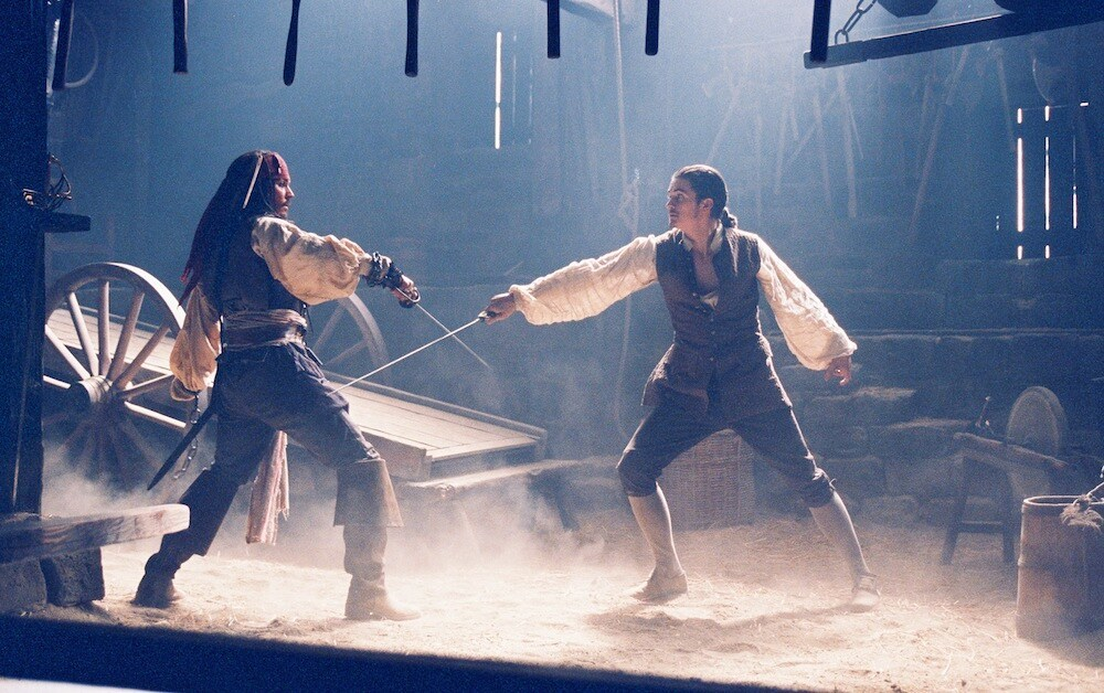 "Actors Johnny Depp (Captain Jack Sparrow) and Orlando Bloom (William Turner) sword-fighting in the film ""Pirates of the Caribbean""l"