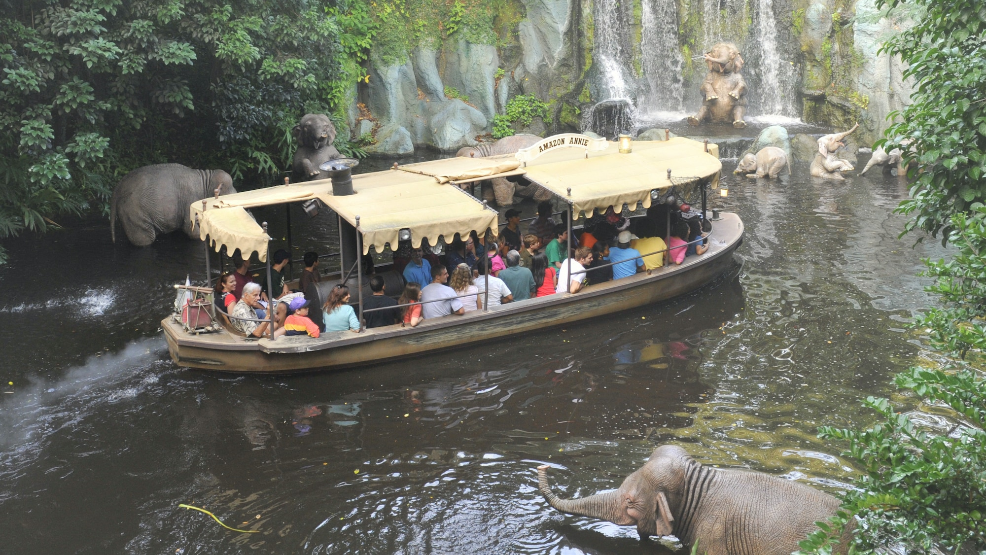 Image of a boat going by an elephant from the Jungle Cruise ride.