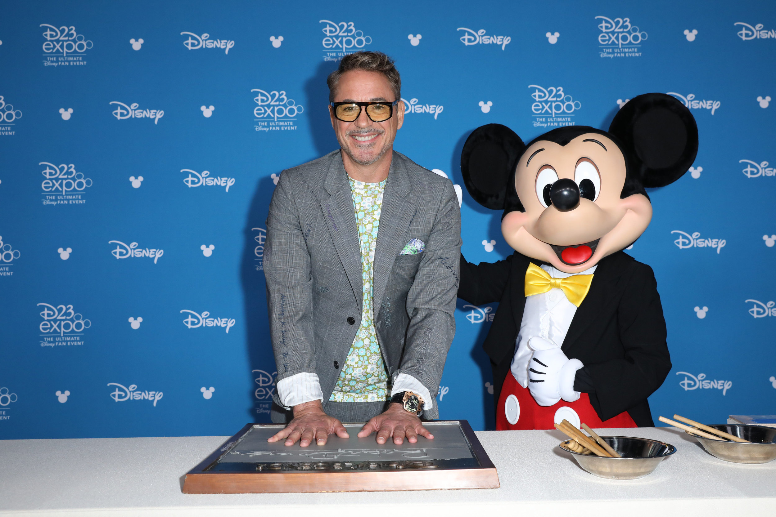 Robert Downey Jr. making his handprints with Mickey