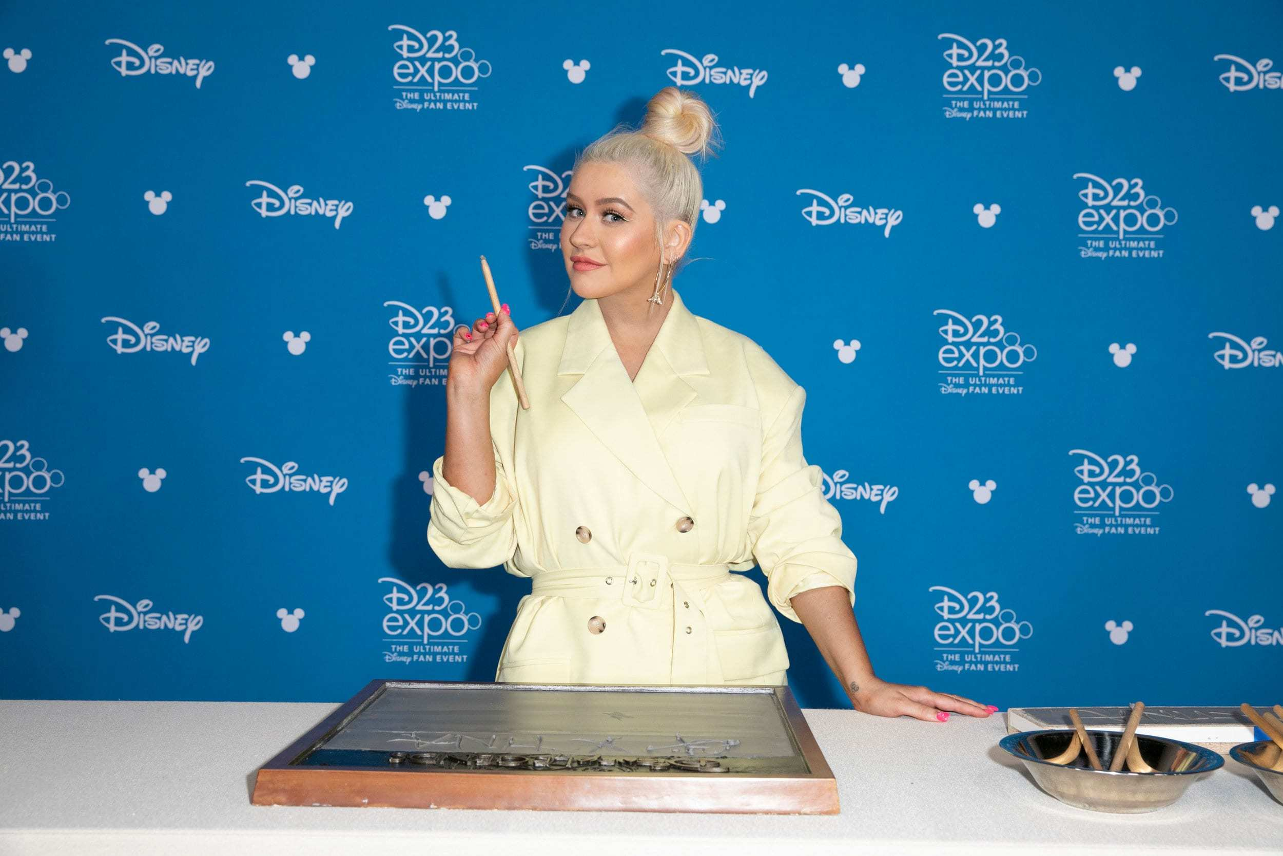 Christina Aguilera at the Disney Legends Awards autographing cement.