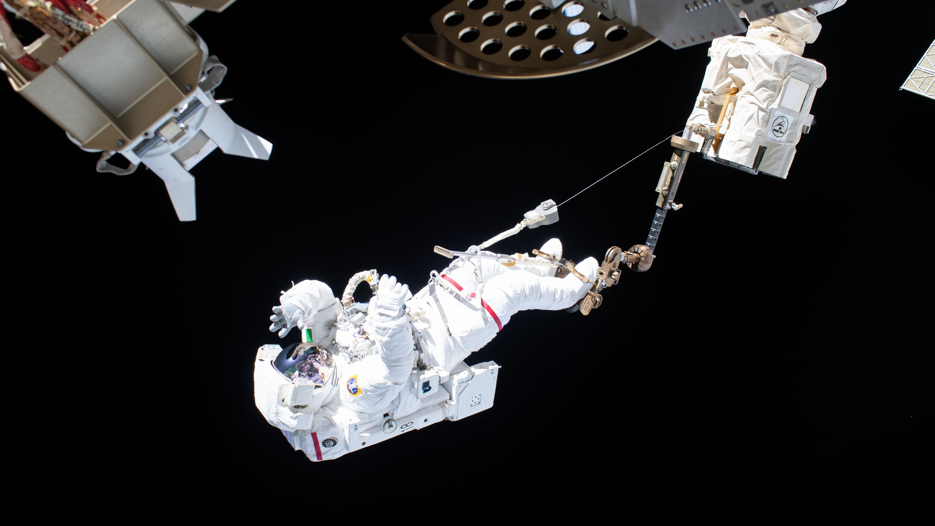 AMONG THE STARS - (Nov. 22, 2019) --- Astronaut Luca Parmitano of ESA (European Space Agency) is attached to an articulating portable foot restraint at the end of the Canadarm2 robotic arm during the second spacewalk to repair the International Space Station's cosmic particle detector, the Alpha Magnetic Spectrometer. (NASA) LUCA PARMITANO