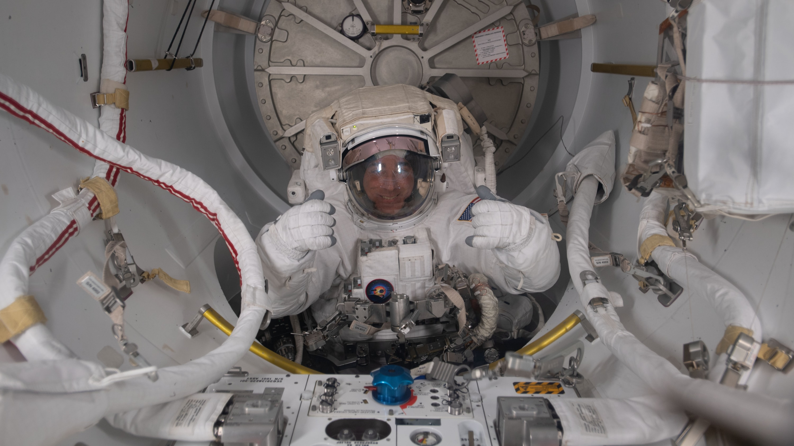 AMONG THE STARS - (July 1, 2020) - NASA astronaut and Expedition 63 Commander is pictured in his U.S. spacesuit halfway inside the crew lock portion of the Quest airlock during a spacewalk to replace batteries on the International Space Station's Starboard-6 truss structure. (NASA) CHRIS CASSIDY