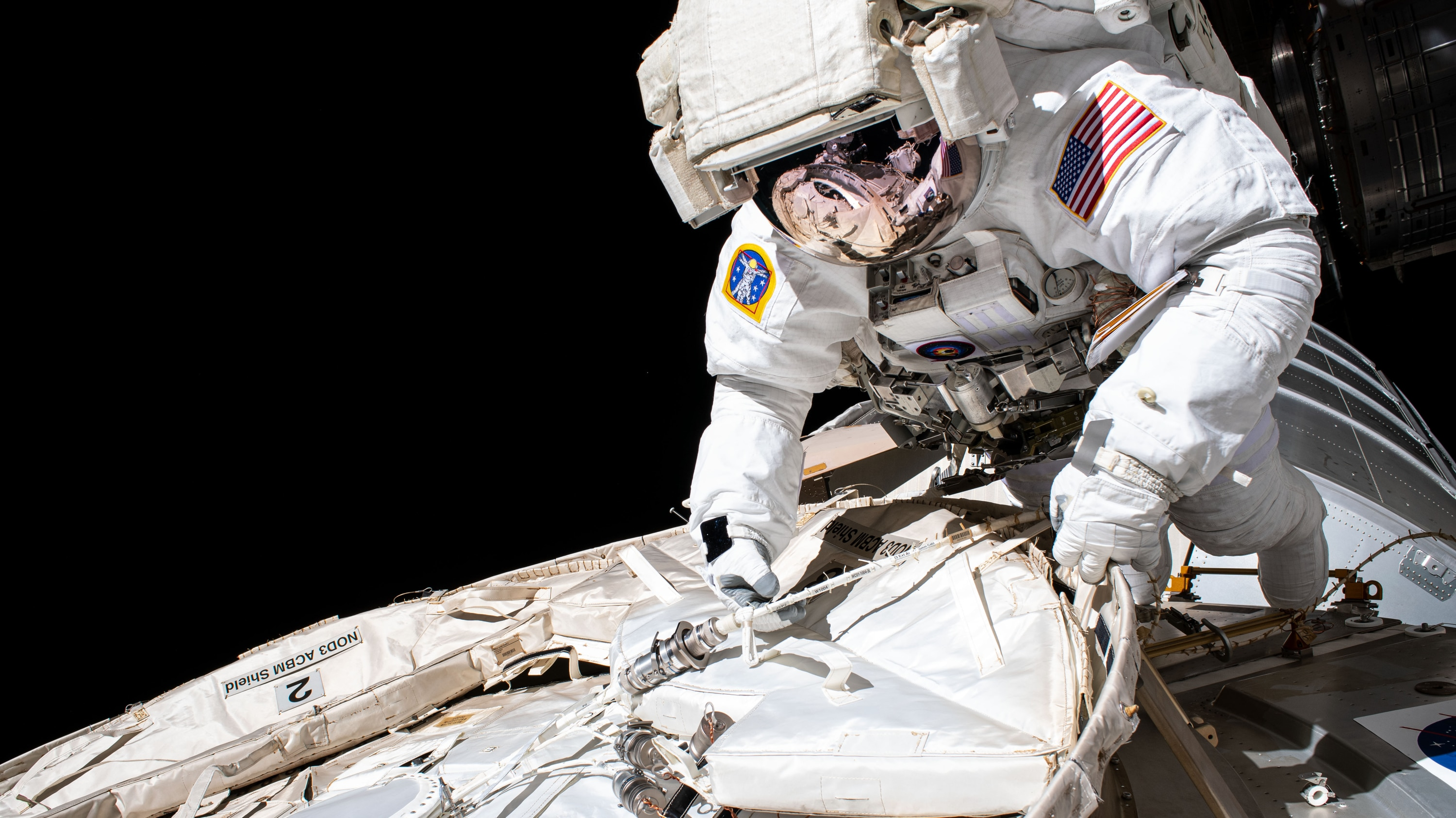 AMONG THE STARS - (July 21, 2020) - NASA astronaut and Expedition 63 Commander Chris Cassidy conducts a spacewalk to set up the Tranquility module for the future installation of a NanoRacks airlock that will enable public and commercial research on the outside of the International Space Station. Cassidy has completed 10 spacewalks throughout his career for a total of 54 hours and 51 minutes spacewalking time. (NASA) CHRIS CASSIDY