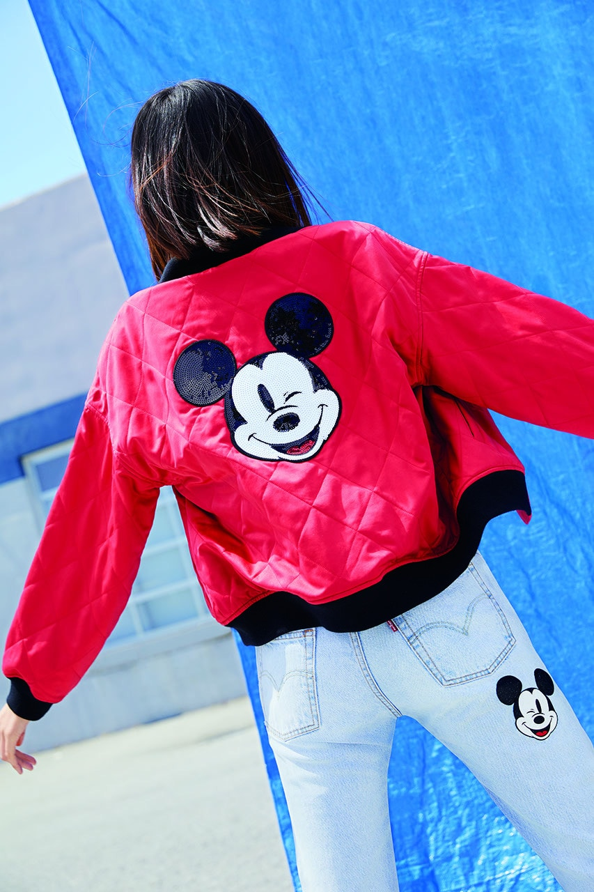 Bright red Levi Mickey Mouse jacket paired with Mickey Mouse denim jeans