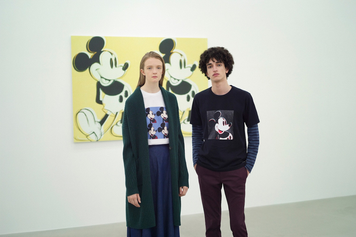 Models in art gallery, wearing clothes with Mickey Mouse prints from Andy Warhol's pop art piece