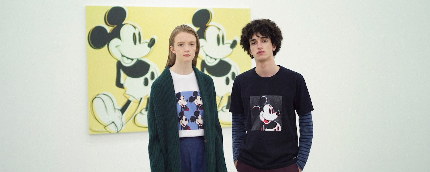 Models in art gallery, wearing clothes with Mickey Mouse prints from Andy Warhol's pop artwork