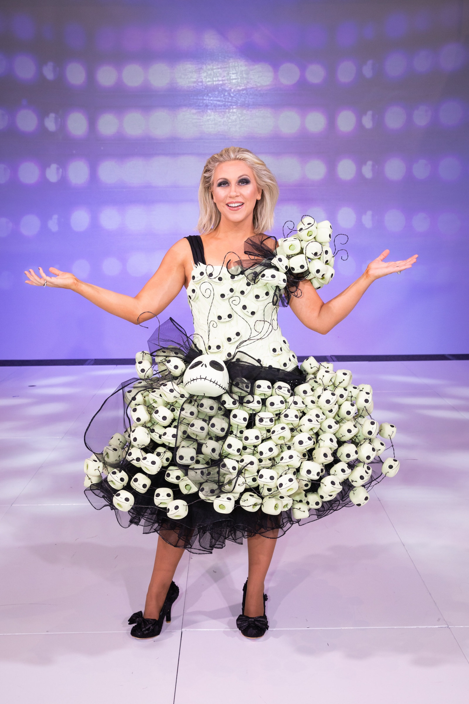 Her Universe's Ashley Eckstein wearing Couture NBC Funko Pop! Dress