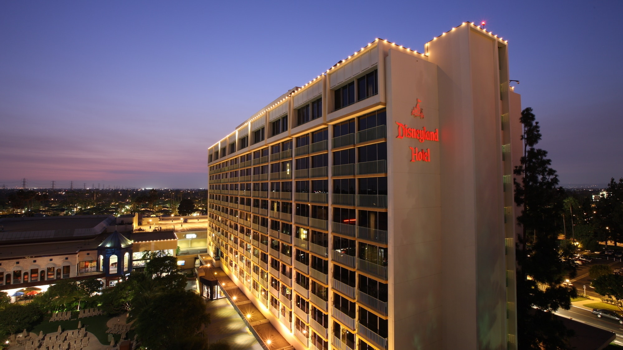 Exterior view of the Disneyland Hotel at dusk.