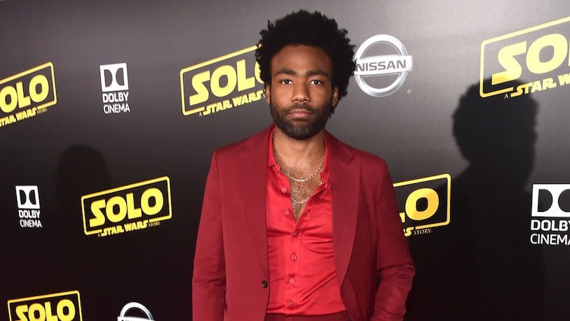 Donald Glover in red suit posing on the Red Carpet