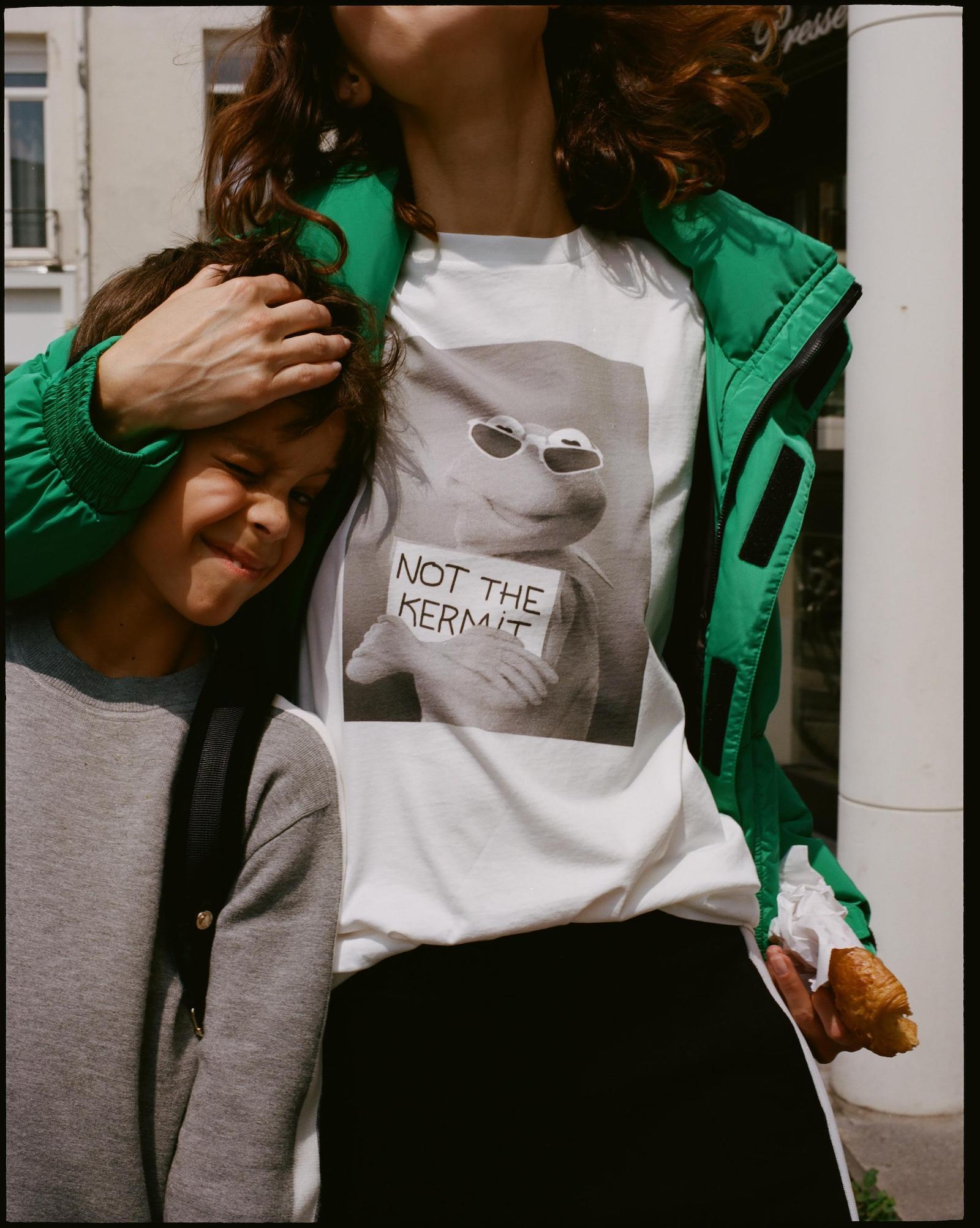 Model wearing white tee shirt featuring Kermit from the Sandro collection