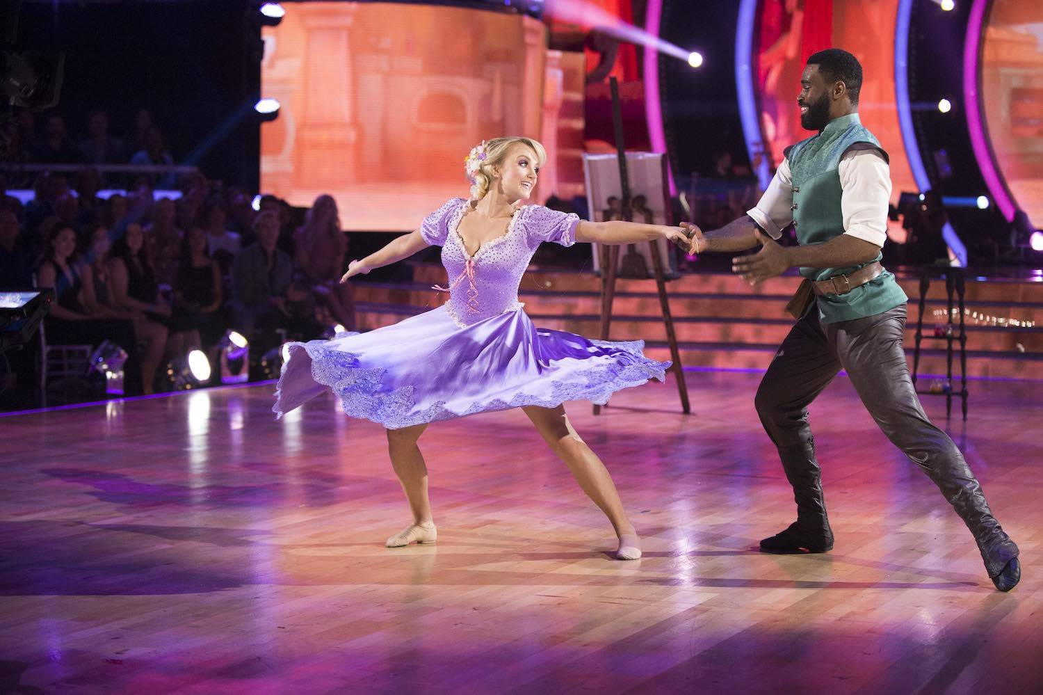 Evanna Lynch and Keo Motsepe dancing, dressed up as Rapunzel and Flynn Rider from Tangled