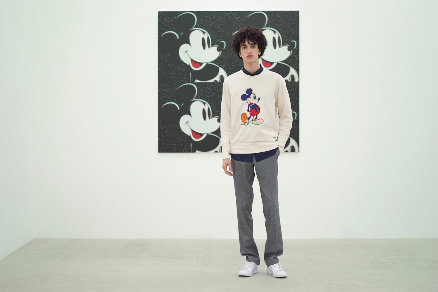 Model wearing a sweatshirt with Andy Warhol's pop art piece