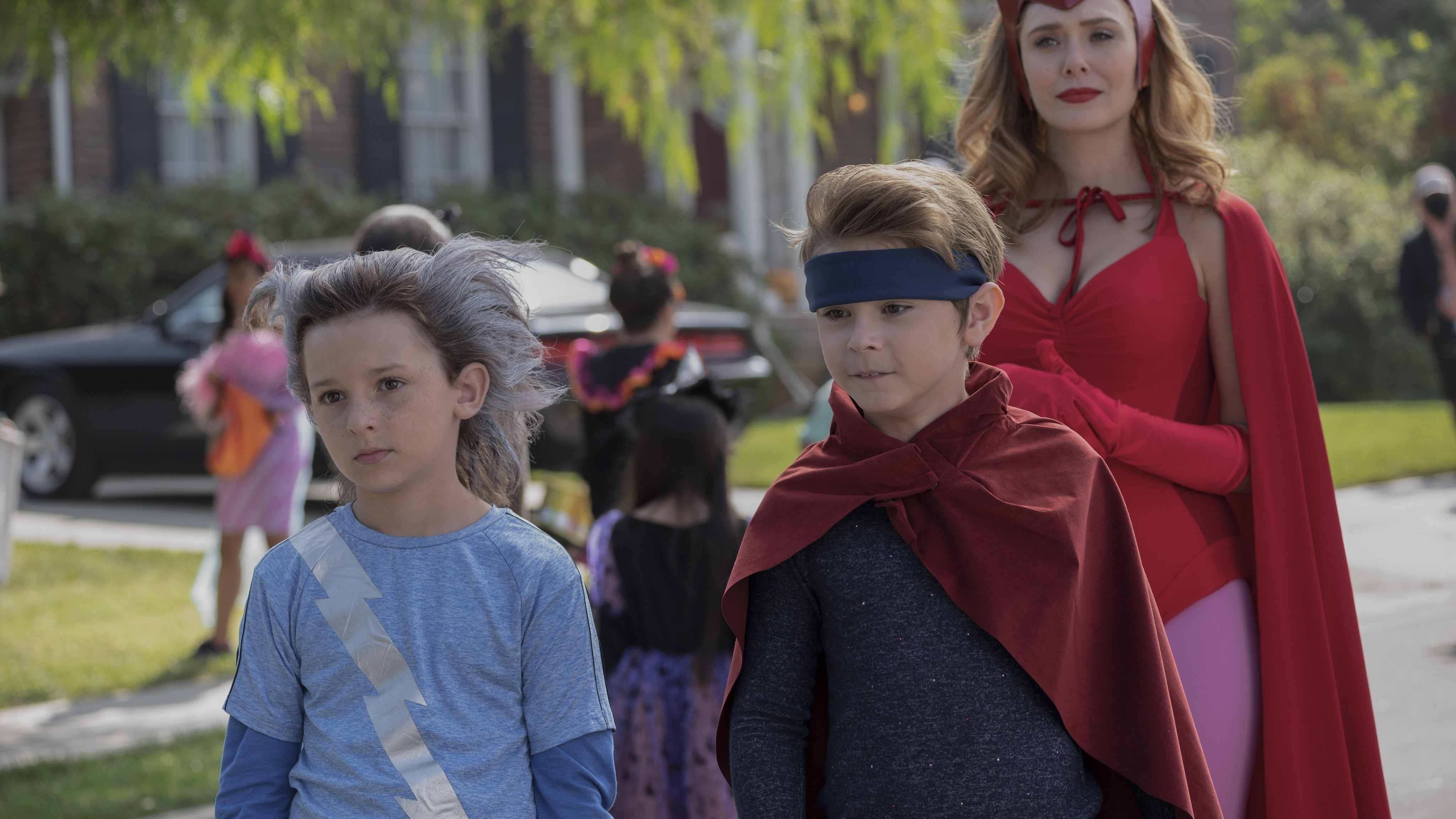 (L-R): Jett Klyne as Tommy, Julian Hilliard as Billy and Elizabeth Olsen as Wanda Maximoff in Marvel Studios' WANDAVISION exclusively on Disney+. Photo by Suzanne Tenner. ©Marvel Studios 2021. All Rights Reserved.