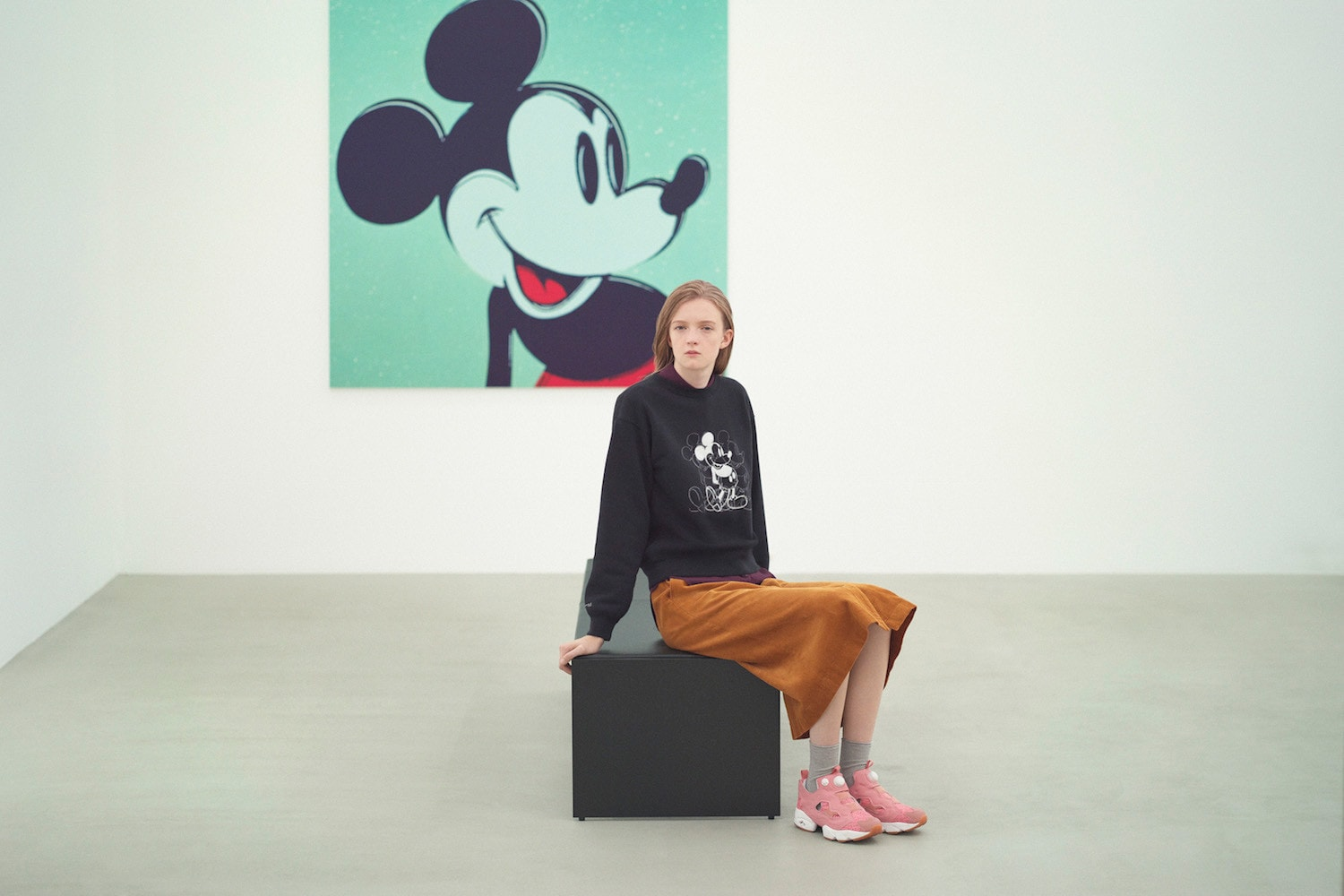 Model wearing a black jumper with Andy Warhol's pop artwork