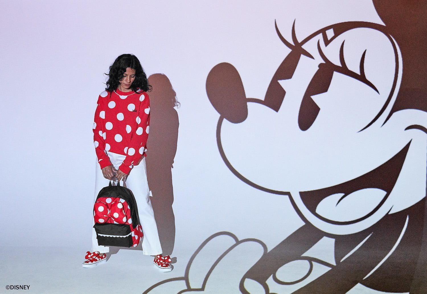 Minnie Mouse sweatshirt, back pack and shoes from the Vans x Disney collection