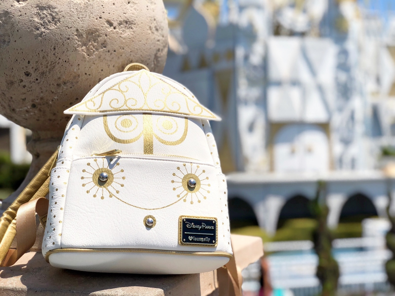 White and gold Disney Parks back pack