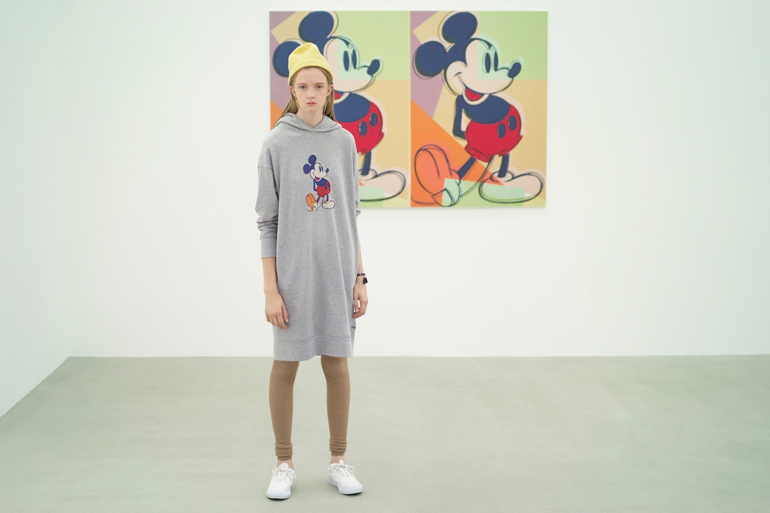 Model wearing a long hoodie featuring Andy Warhol's pop artwork