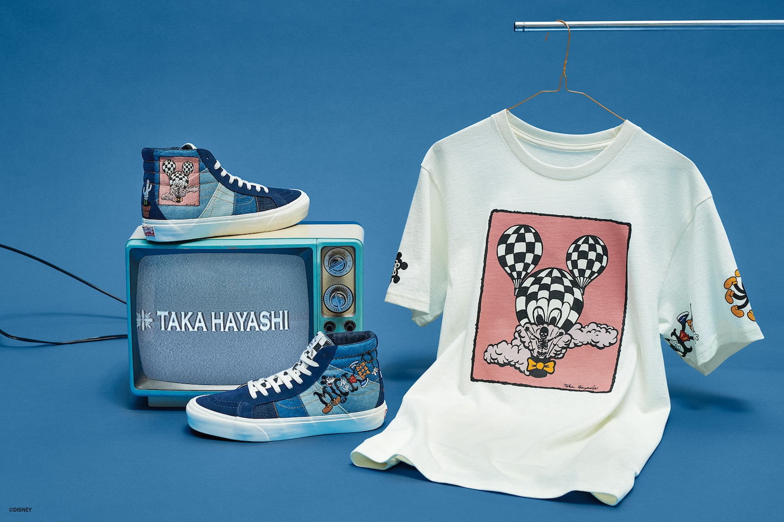 Sneakers and a tee shirt from the Vault by Vans Mickey Mouse collection
