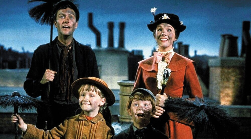 Bert, Mary Poppins and the children covered in soot.