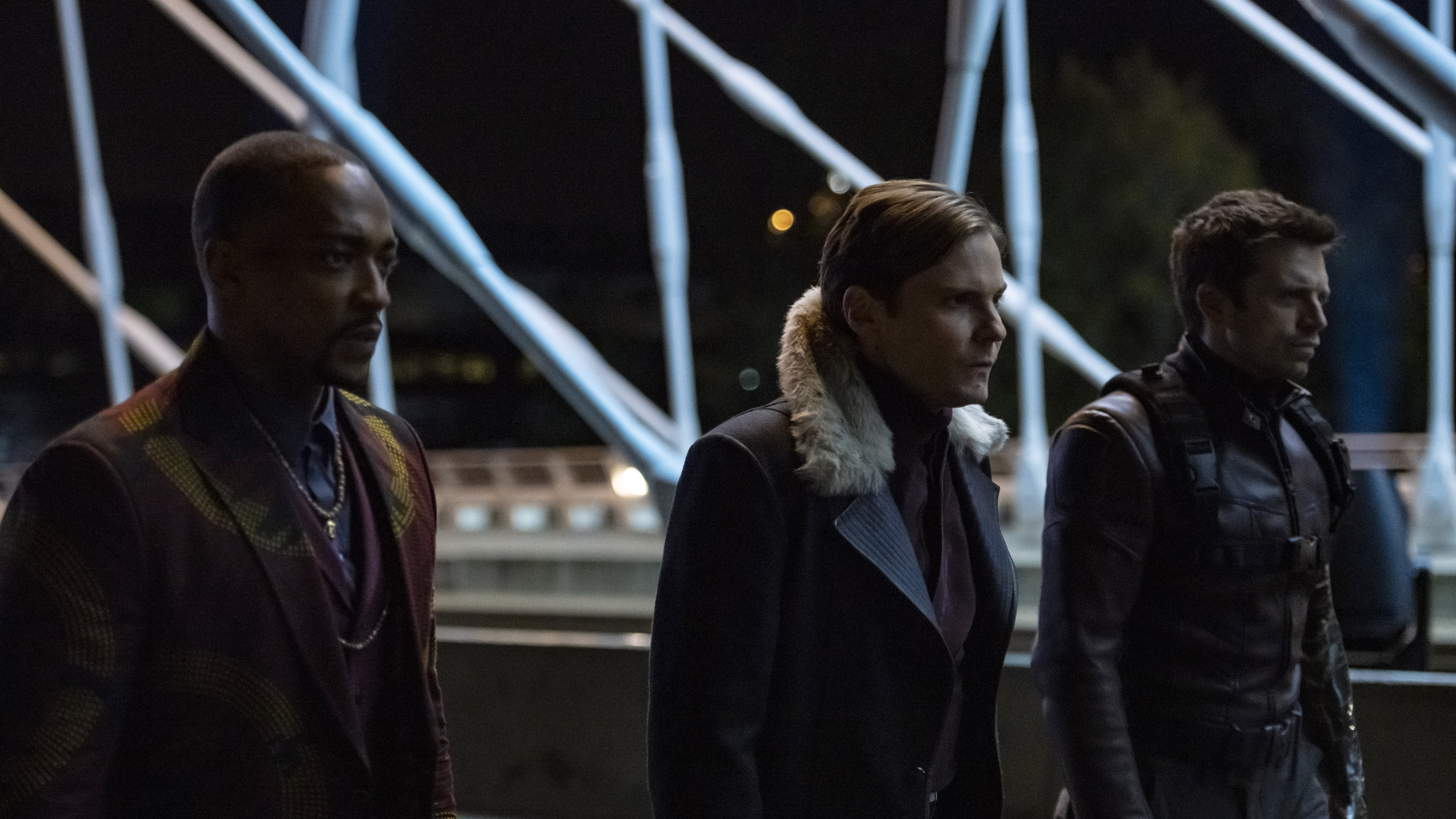 (L-R): Falcon/Sam Wilson (Anthony Mackie), Zemo (Daniel Brühl) and Winter Soldier/Bucky Barnes (Sebastian Stan) in Marvel Studios' THE FALCON AND THE WINTER SOLDIER exclusively on Disney+. Photo by Julie Vrabelová. ©Marvel Studios 2021. All Rights Reserved.
