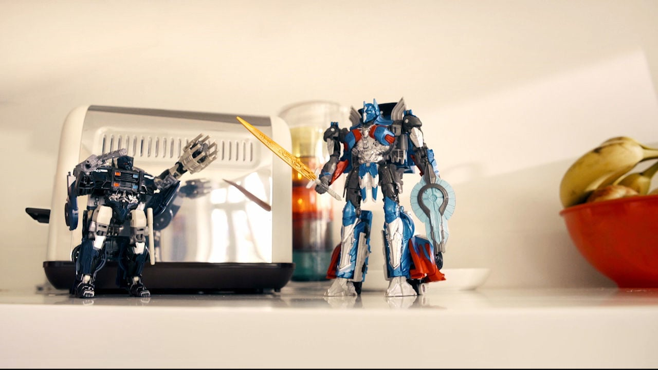 Optimus and Barricade battle over breakfast! By Lily, aged 8