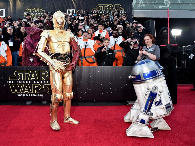 Despite their differences, C-3P0 and R2-D2 were happy to have their photographs taken together on...