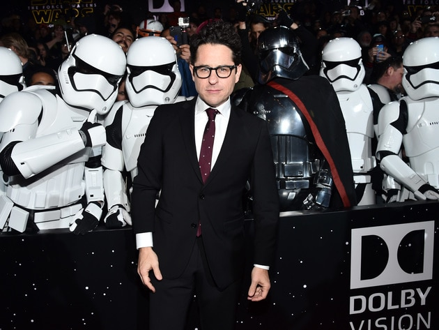 The film's director, J. J. Abrams, poses with (friendly) Stormtroopers.