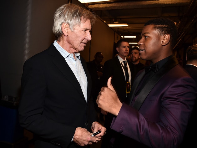 Original cast member Harrison Ford (left) talks to new co-star John Boyega.
