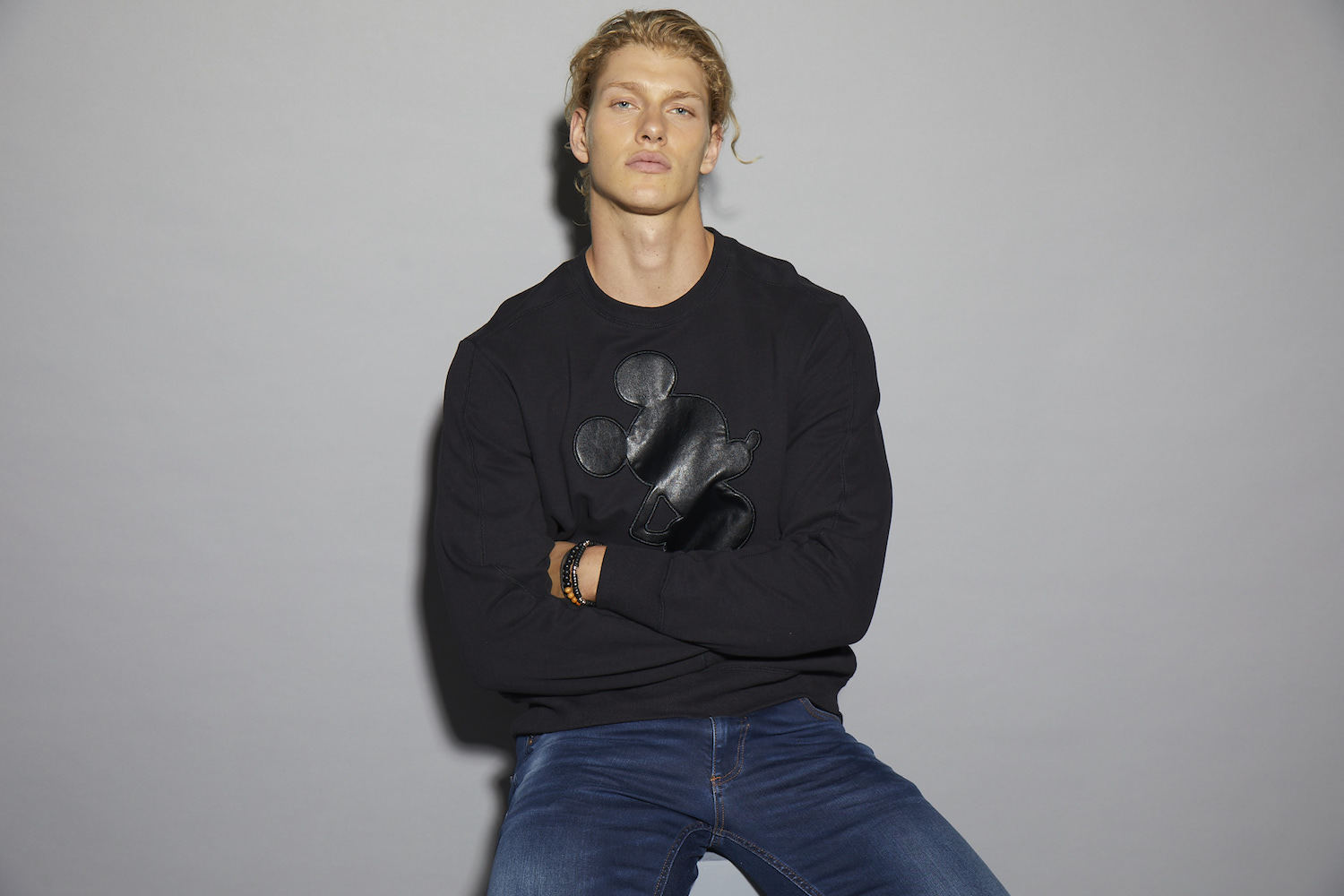 Model sporting black Mickey Mouse sweatshirt from the Gold collection