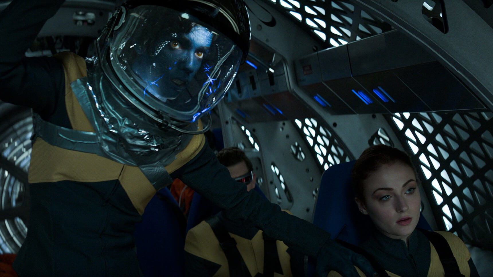 "Actor Sophie Turner (as Jean Grey/Phoenix), Kodi Smit-McPhee (as Kurt Wagner/Nightcrawler and Tye Sheridan (Scott Summers/Cyclops) in a spacecraft in the movie ""X-Men: Dark Phoenix"""