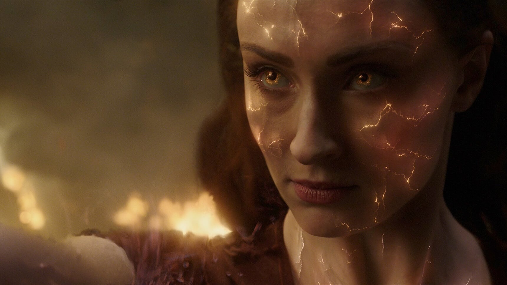 "Actor Sophie Turner (as Jean Grey/Phoenix)face glowing in the movie ""X-Men: Dark Phoenix"""