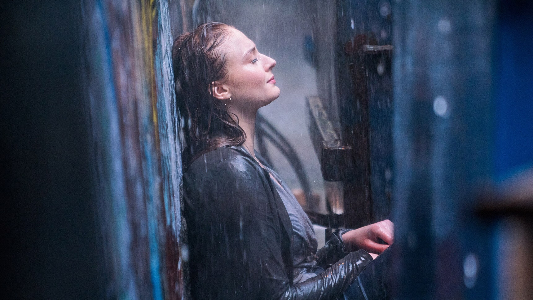 "Actor Sophie Turner (as Jean Grey/Phoenix) sitting in the rain in the movie ""X-Men: Dark Phoenix"""
