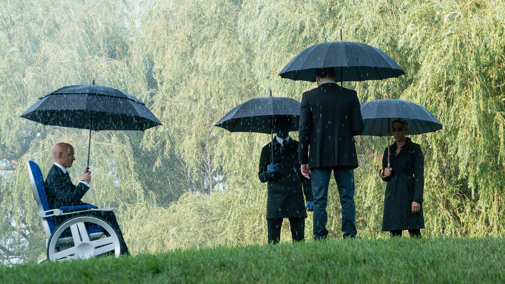 "X-Men standing in the rain with umbrellas in the movie ""X-Men: Dark Phoenix"""