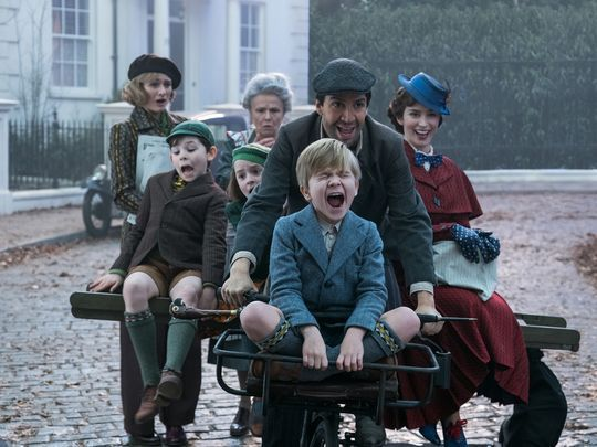 Characters from Mary Poppins Returns on a bicycle cart