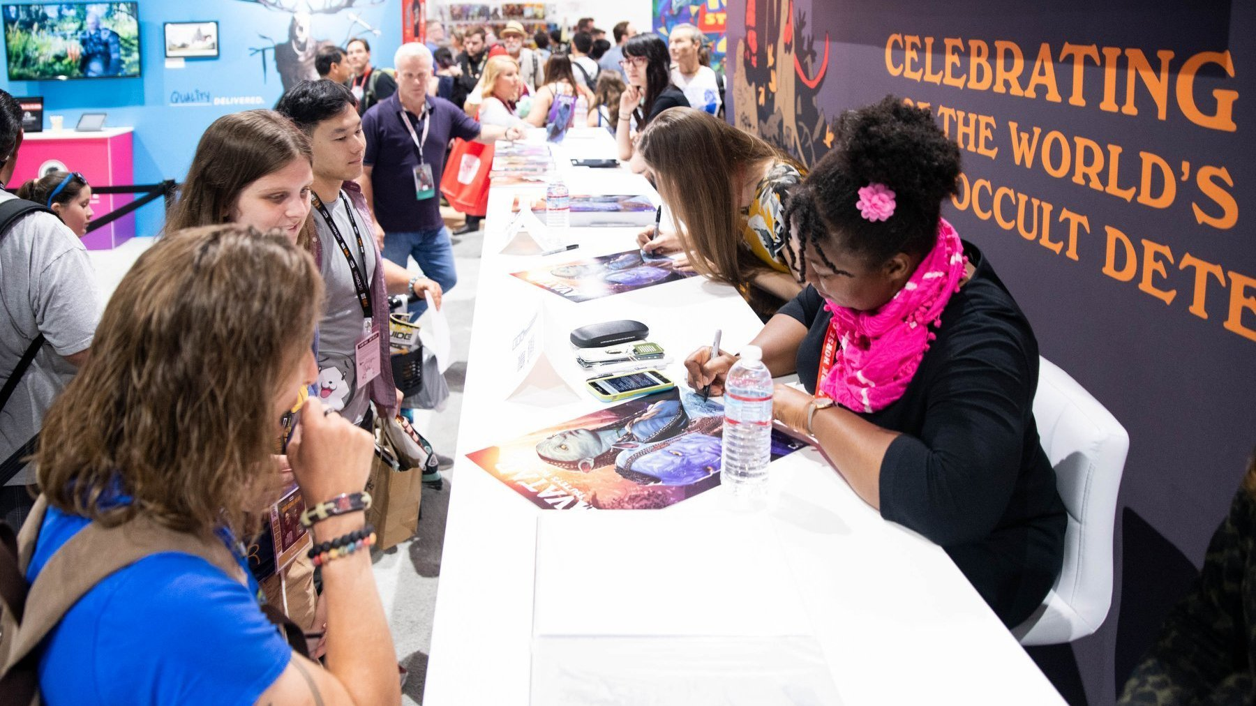 Shea and Sherri signing comics and prints for Avatar fans