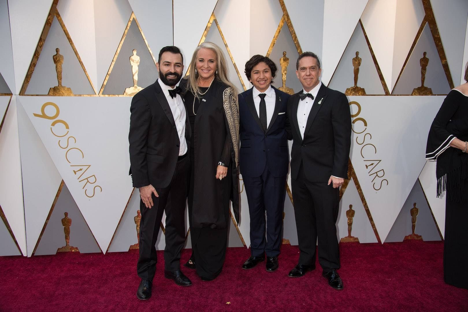 ADRIAN MOLINA, DARLA K. ANDERSON, ANTHONY GONZALEZ, AND LEE UNKRICH AT THE OSCARS