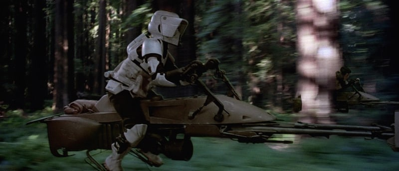 Scout trooper rides 74-Z bike on Endor