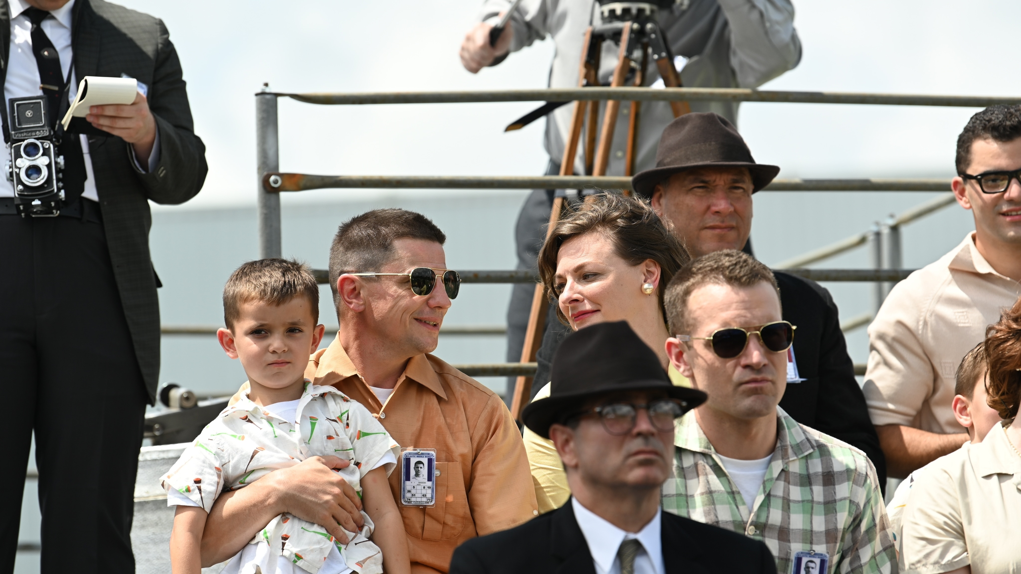 Gus Grissom played by Michael Trotter and Betty Grissom played by Rachel Buttram sit with their child watching the launch of a test rocket in National Geographic's THE RIGHT STUFF streaming on Disney+. (National Geographic/Gene Page)