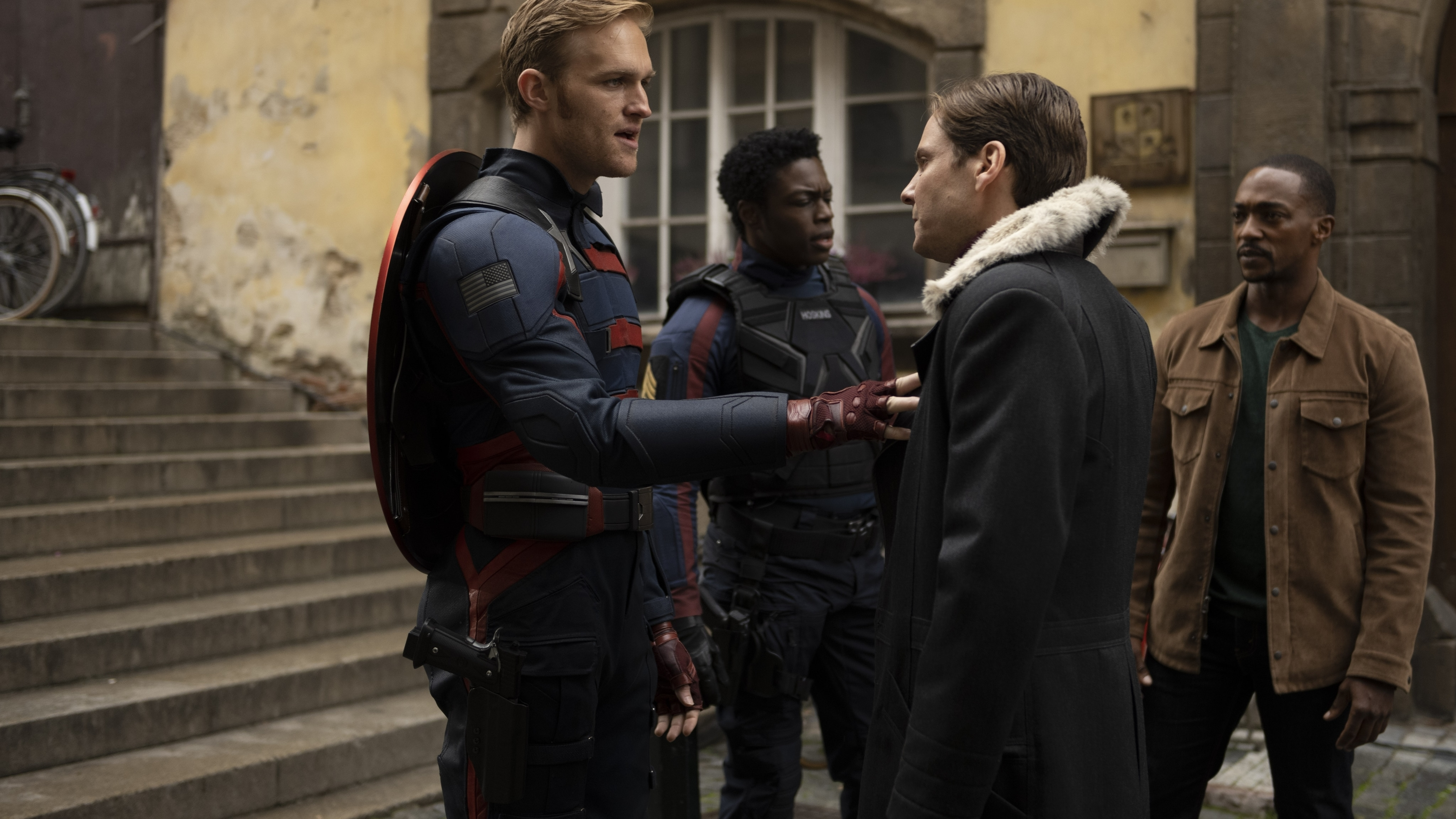 (L-R): John Walker (Wyatt Russell), Lemar Hoskins (Clé Bennett), Zemo (Daniel Brühl) and Falcon/Sam Wilson (Anthony Mackie) in Marvel Studios' THE FALCON AND THE WINTER SOLDIER exclusively on Disney+. Photo by Julie Vrabelová. ©Marvel Studios 2021. All Rights Reserved.