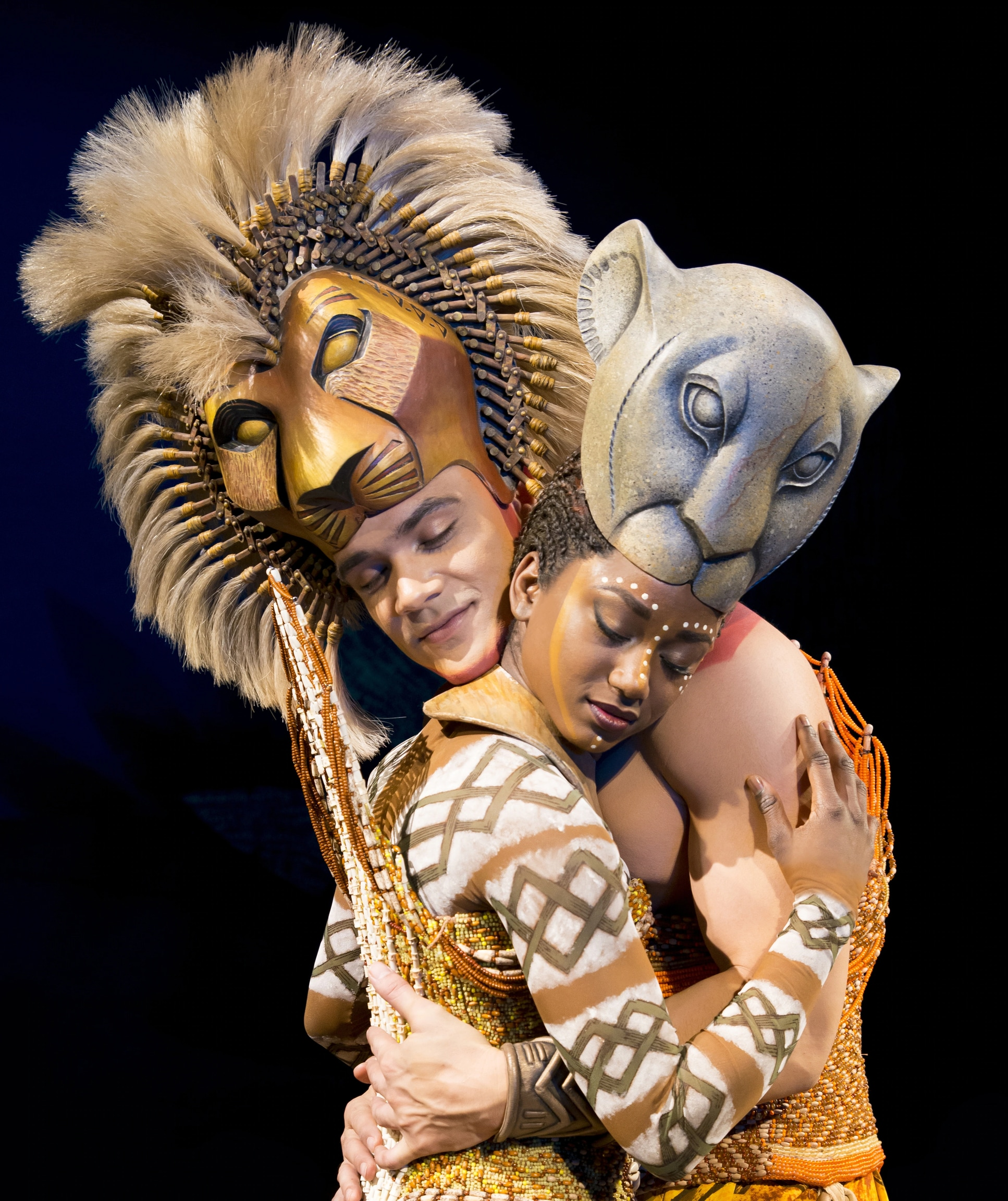 Janique Charles as Nala embracing Simba in The Lion King the Musical