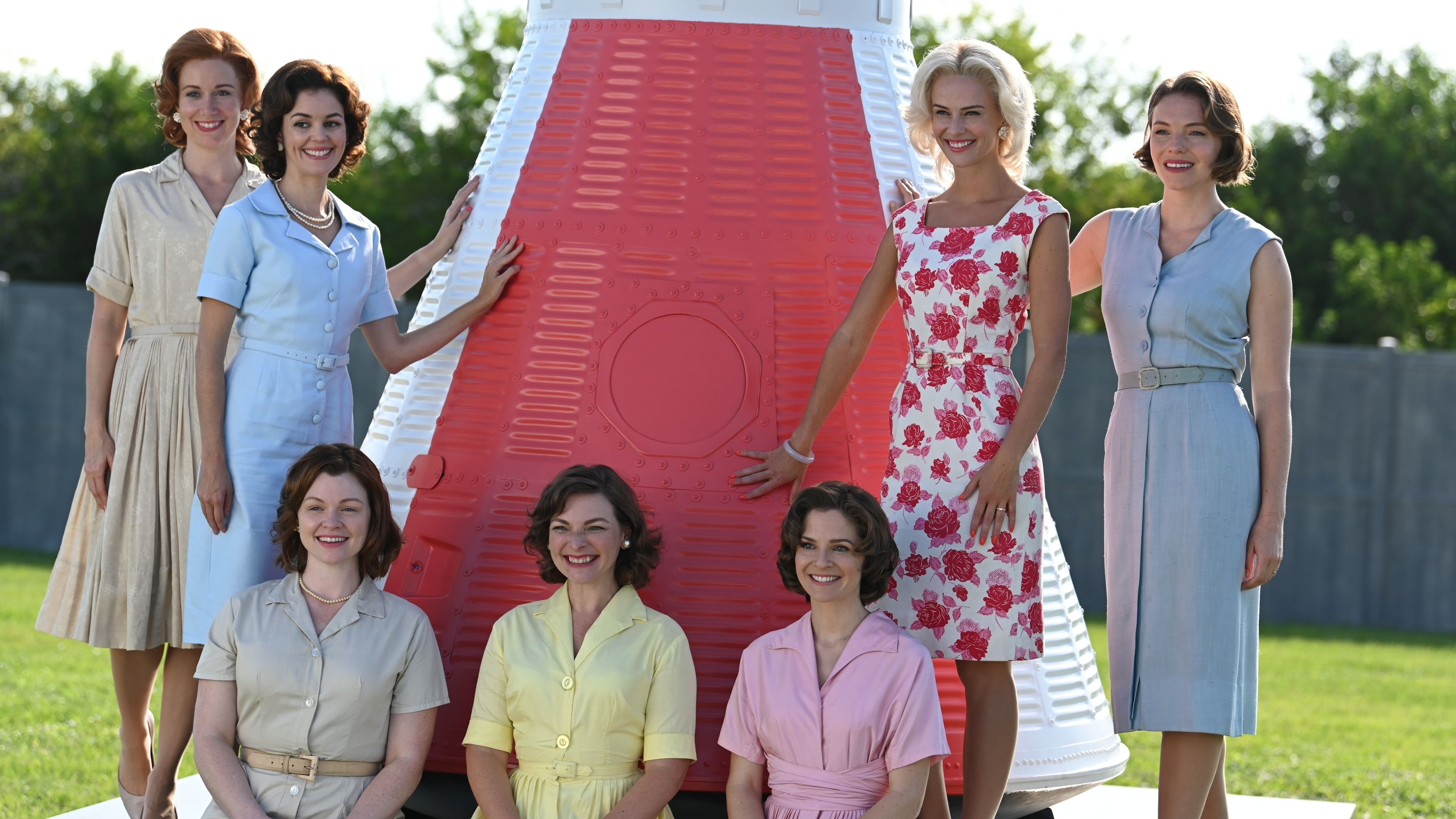 L to R: Laura Ault as Jo Schirra, Nora Zehetner as Annie Glenn, Victoria White as Marge Slayton, Rachel Buttram as Betty Grissom, Shannon Lucio as Louise Shepard, Jade Albany Pietrantonio as Rene Carpenter and Eloise Mumford as Trudy Cooper pose for LIFE Magazine group photo in National Geographic's THE RIGHT STUFF streaming on Disney+. (National Geographic/Gene Page)