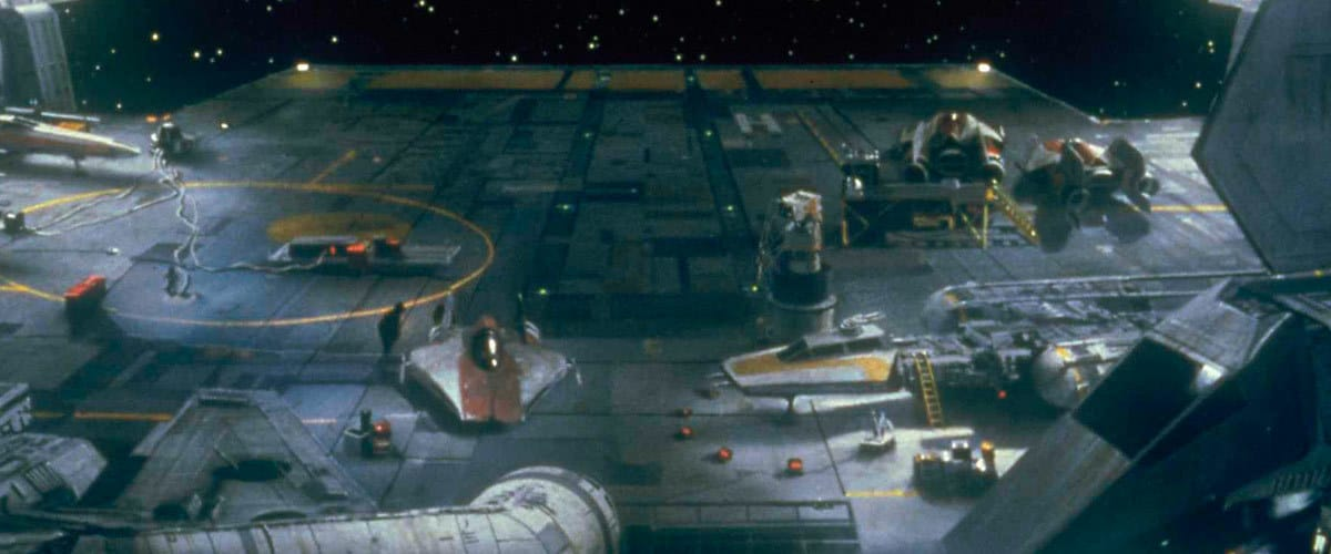 An A-Wing docked next to assorted Rebellion starfighters