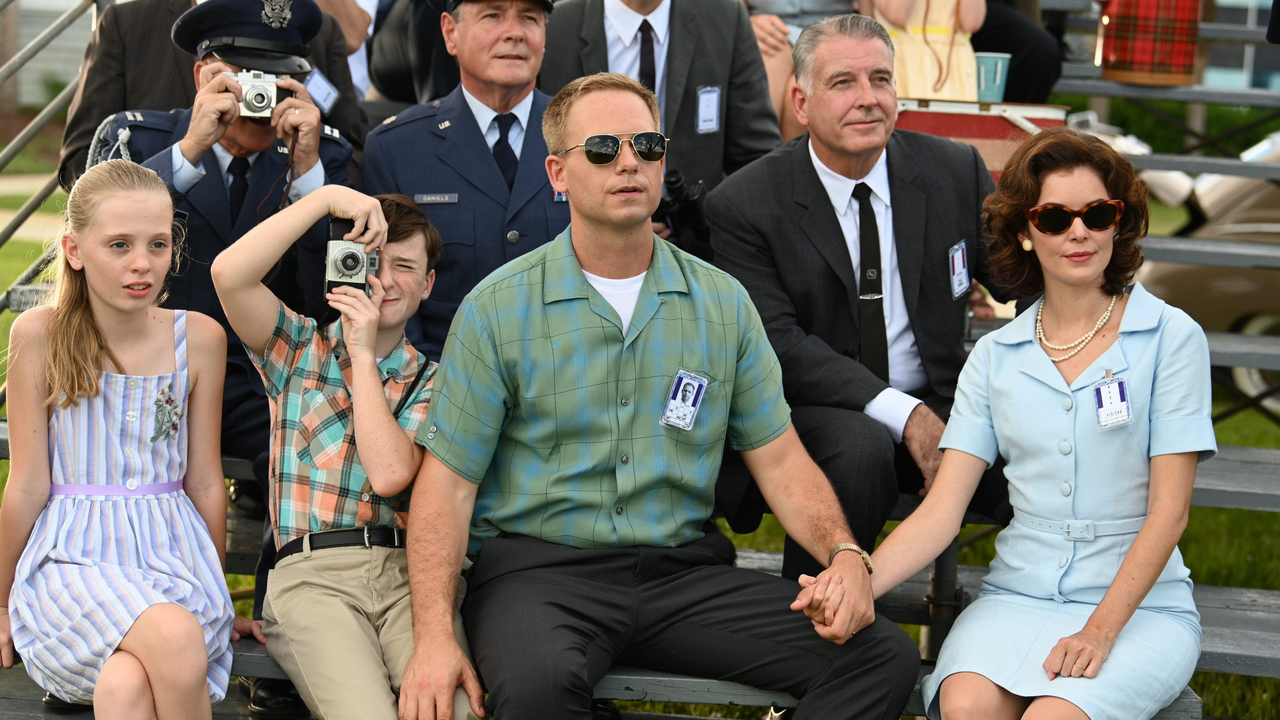 John Glenn played by Patrick J. Adams and Annie Glenn played by Nora Zehetner sit with their children watching the launch of a test rocket in National Geographic's THE RIGHT STUFF streaming on Disney+. (National Geographic/Gene Page)